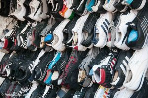 The shoes donated in a running shoe drive fundraiser create work opportunities in developing nations through micro-enterprise.